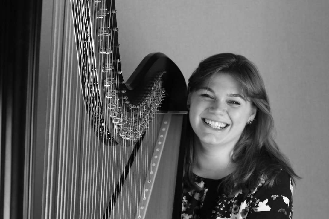 smiling black and white harpist
