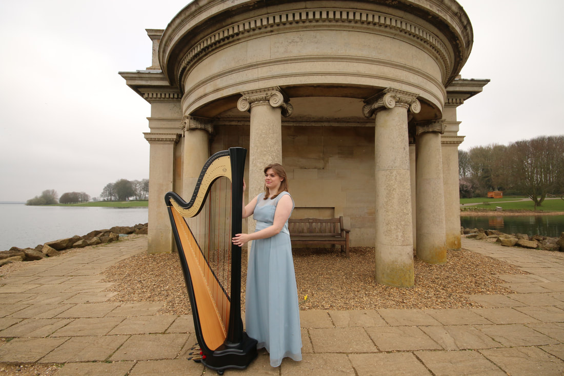 posing harpist at normanton church on rutland water